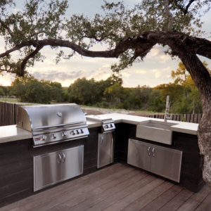 Outdoor Concrete Kitchen Sink under oak tree covered patio
